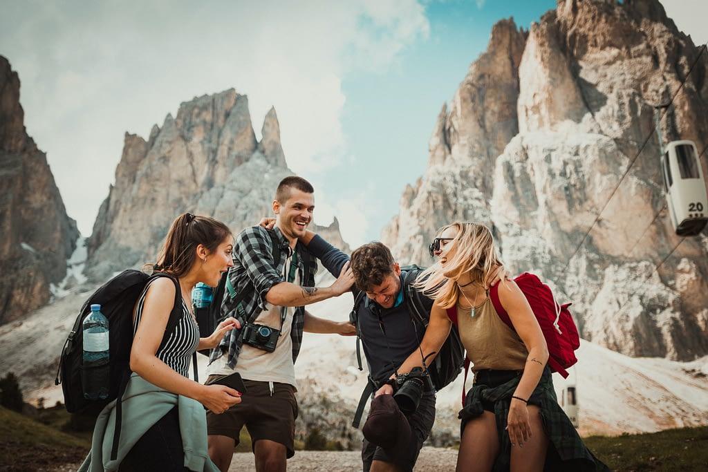 four friends trekking on a mountain having fun