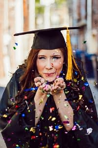 Girl celebrating on her college graduation day